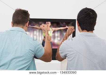 Fit woman celebrating victory with arms stretched against two excited soccer fans watching tv