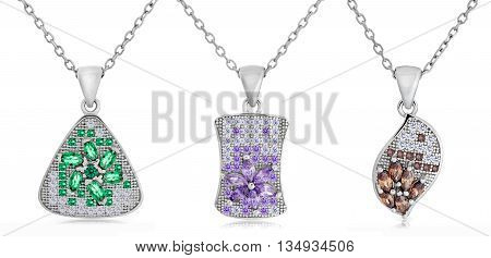 Three Silver Pendants Of Different Shapes On A Chain