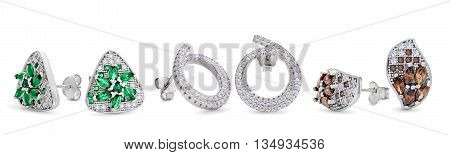 Three Pairs Of Silver Stud Earrings Of Different Forms On A White Background