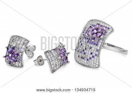 Silver Ring And Pair Stud Earrings Over A White Background