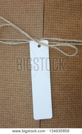 Parcel tied with string with white address label attached