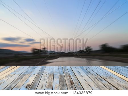 Wood floor on blured high voltage post background