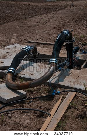 Rubber and metal tube that is used to control the water watering the farmland