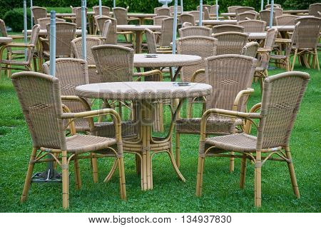 beautiful garden tables rattan material in a green garden