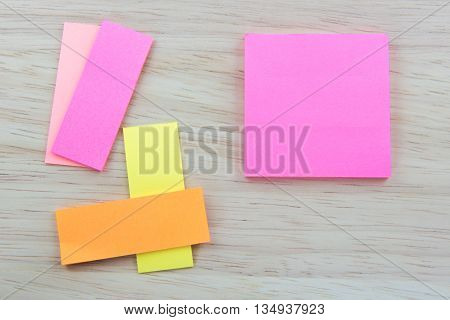 Color  Paper notes with sticky note on Wood Background