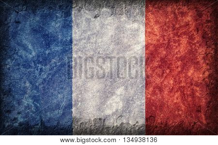 Flag of France painted onto a rough wall