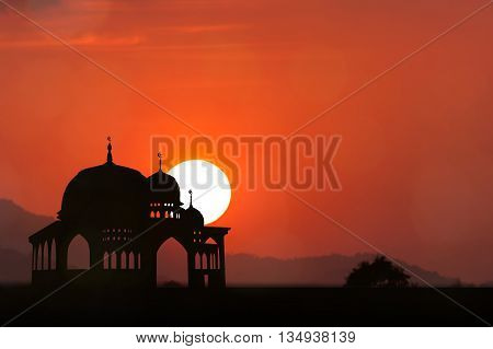 Silhouette of Mosque orange sunset natural  background