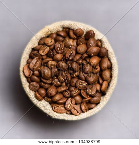 Coffee Beans In Flax Sack On Grey Background