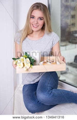 Young Woman Having Breakfast At Home