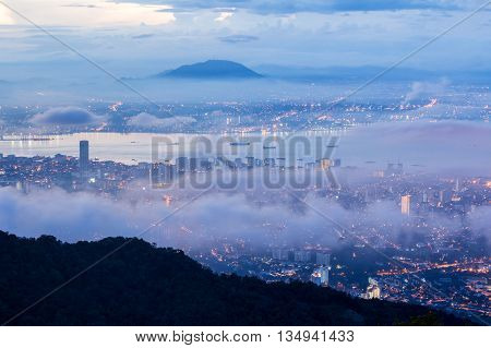 Sunrise above the cloud view of George Town City from Penang Hill, Malaysia
