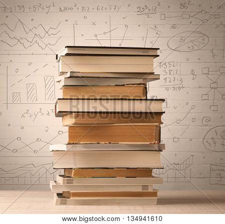 A pile of books with math formulas written in doodle style on background