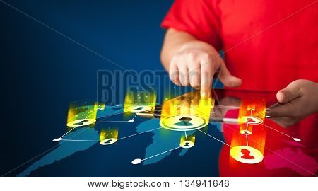 Hand holding tablet device with social network map concept on background