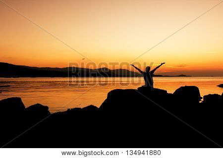 Women happy and free open arms on beach sunset background