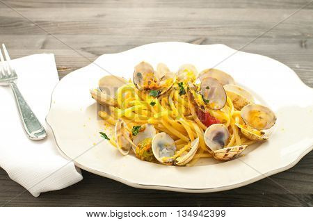 Delicious pasta with clams mullet and pumpkin flowers italy