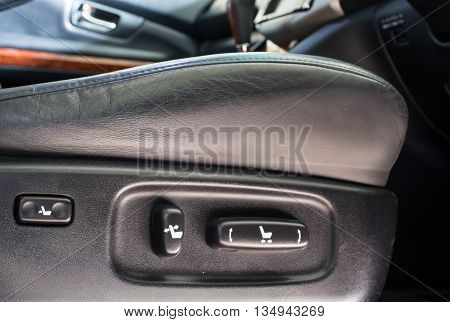 Close up look at adjustment buttons in automobile interior