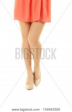 Female Legs With Beige High Heels On A White Background