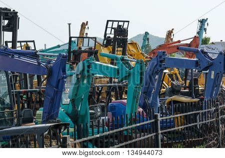 Colorful picture of heavy duty equipment at a parking lot