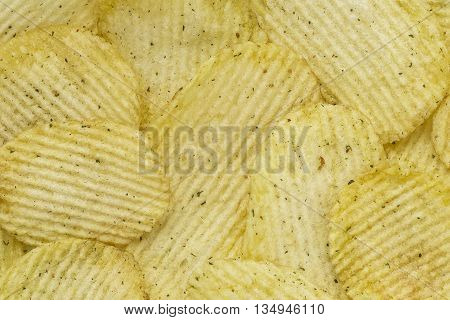 Rippled Potato Chips Background. With onion. Top view