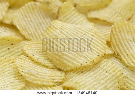 Rippled Potato Chips Background. With onion. Side view