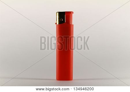 Red Cigarette Gas Lighter On White Background