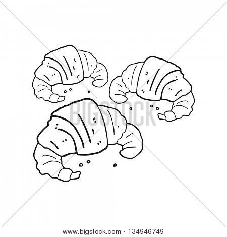 freehand drawn black and white cartoon croissants