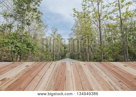 Wood floor on Road beautiful forest wayside background