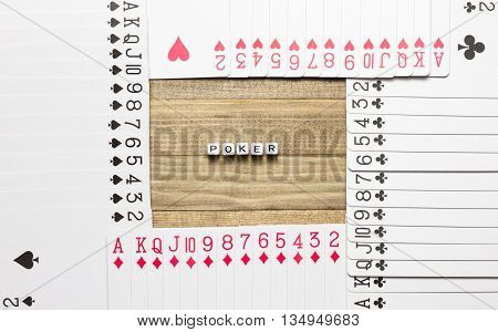 poker text inside border made of play card