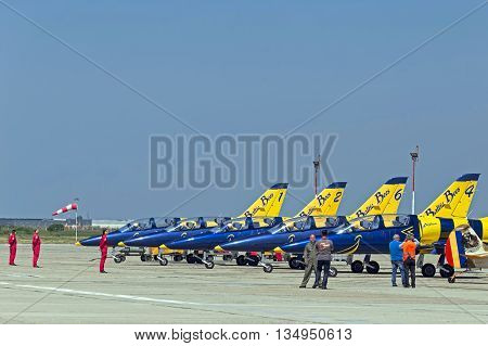 TIMISOARA ROMANIA - MAY 21 2016: Fighter jets lineup on landing after a local air show. Baltic Bees team.