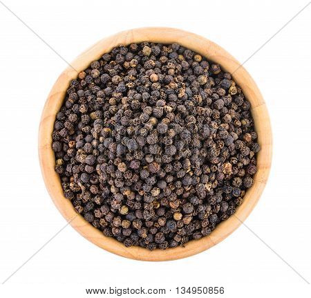 peppercorn in wood bowl isolated on white background