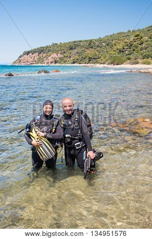 AvlakiGreece - June 15 2006 : Two scuba divers ready to dive at a local dive site.
