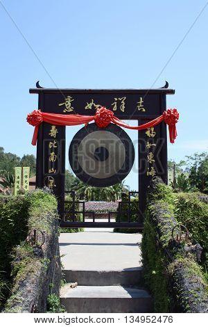 Chinese altar gong in park in Sanya, Hainan (China)