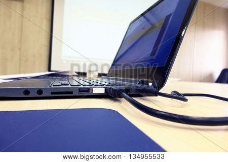 Close-up of laptop in meeting room / Laptop in meeting room