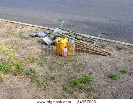 Tools for repair of roads, lying on the roadside