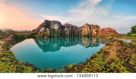 Beautiful green lake reflection of mountain view in Penang, Malaysia