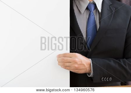 Hand of businessman pull white background foe present