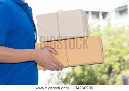 Delivery man holding a parcel box Delivery service concept