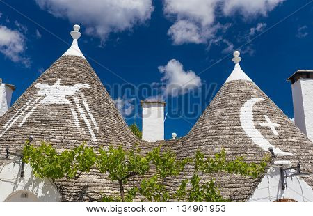 Detail of roofs and signs of the trulli houses Alberobello town Apulia region Southern Italy