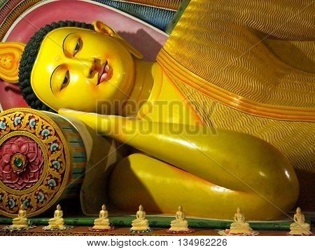 Ancient Buddha reclining statue Sri Lanka. Artistic retouching.
