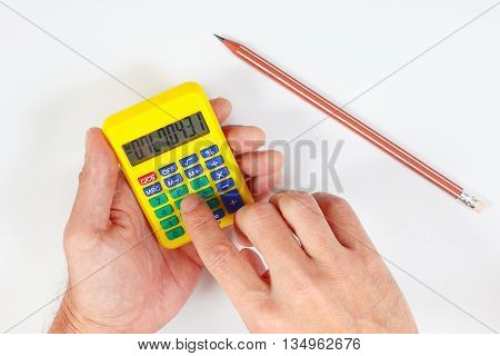 Hands calculate using a pocket digital calculator on a white background