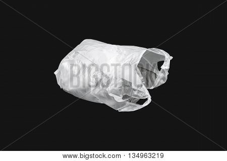 White inflated plastic bag isolated on black background