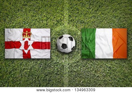Northern Ireland Vs. Ireland Flags On Soccer Field
