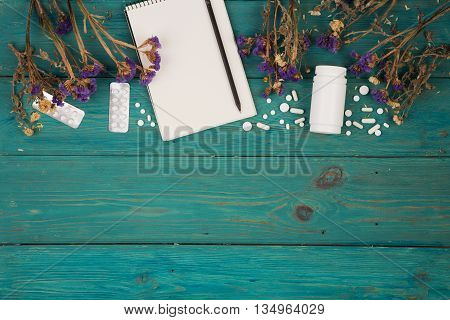 Workplace Of Doctor - Medicine Clipboard, Bottle, Flower And Pils
