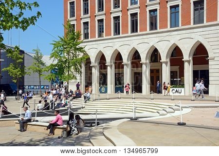 BIRMINGHAM, UNITED KINGDOM - JUNE 6, 2016 - People relaxing in the Summer sunshine at Central Square in Brindleyplace Birmingham England UK Western Europe, June 6, 2016.
