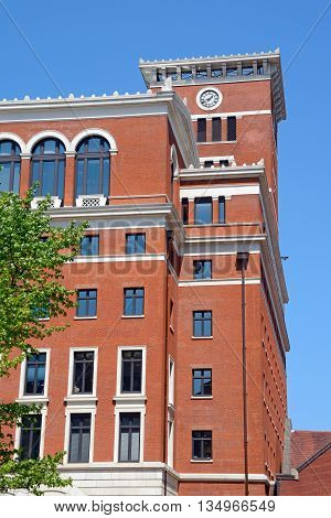 Brick office block with a clock tower in Brindleyplace Birmingham England UK Western Europe.