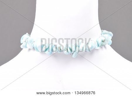 Colorful and crisp image of splintered larimar chain on bust