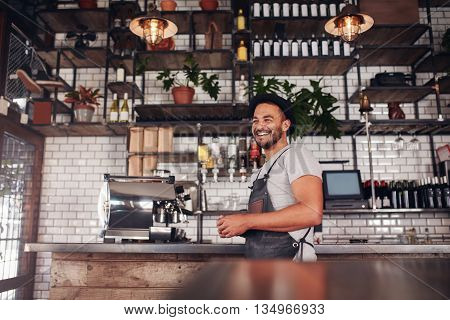 Happy Young Bar Owner Standing At The Counter