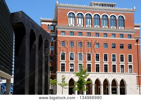 BIRMINGHAM, UNITED KINGDOM - JUNE 6, 2016 - Brick office block with a bronze aquaduct sculpture to the left hand side in Brindleyplace Birmingham England UK Western Europe, June 6, 2016.