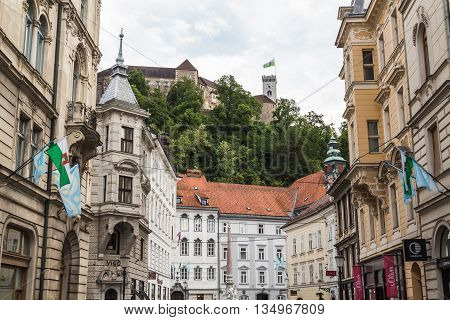 LJUBLJANA SLOVENIA - 26TH MAY 2016: A view towards Town Square Ljubljana during the day. Ljubljana Castle can be seen in trhe distance.