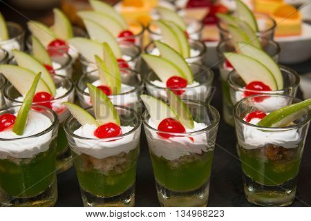 Appetizers mini desserts on catering buffet in glass