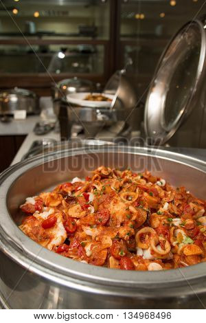 Main dishes served in international buffet restaurant at hotel